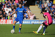 AFC Wimbledon defender George Francomb (7) taking on Southend United defender Ben Coker (3) during the EFL Sky Bet League 1 match between AFC Wimbledon and Southend United at the Cherry Red Records Stadium, Kingston, England on 25 March 2017. Photo by Matthew Redman.