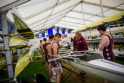 © Licensed to London News Pictures. 28/06/2017. London, UK. A team form St Georges College Boat Club prepare for a race at Day one of the Henley Royal Regatta, set on the River Thames by the town of Henley-on-Thames in England.  Established in 1839, the five day international rowing event, raced over a course of 2,112 meters (1 mile 550 yards), is considered an important part of the English social season. Photo credit: Ben Cawthra/LNP