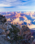 Afternoon sun creates patterns of light and shadow along the south rim of the Grand Canyon.