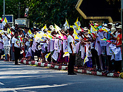 27 NOVEMBER 2017 - YANGON, MYANMAR:  People with Myanmar and Vatican flags wait to see Pope Francis on his motorcade route into Yangon. Pope Francis arrived in Yangon Monday for a four day / three night visit. Tuesday he is going to the capitol, Naypyidaw (Nay Pyi Taw) to meet with Aung San Suu Kyi and other Myanmar leaders. Wednesday and Thursday he is saying mass in Yangon and on Thursday afternoon he is going to neighboring Bangladesh. There are around 450,000 Catholics in Burma, about 1% of the total population.  PHOTO BY JACK KURTZ