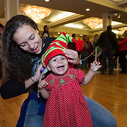 Children and adults enjoy Santa's Workshop during Christmasville in Old Town.