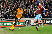Hull City midfielder Mohammed Diame,Burnley defender Michael Keane during the Sky Bet Championship match between Hull City and Burnley at the KC Stadium, Kingston upon Hull, England on 26 December 2015. Photo by Ian Lyall.