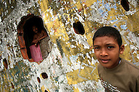A young boy on the streets of San Miguel, a poor barrio in Panama City, Panama on Saturday, September 8, 2007. (Photo/Scott Dalton)..