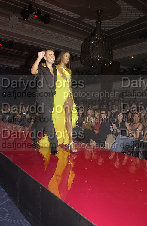 Naomi Campbell and Julian Macdonald. Julian Macdonald  fashion show, Le Meridien Grosvenor House. After party, Il Bottaccio, Grosvenor Place. London. 14 September 2002. © Copyright Photograph by Dafydd Jones 66 Stockwell Park Rd. London SW9 0DA Tel 020 7733 0108 www.dafjones.com