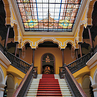 Staircase Inside of the Archbishop's Palace in Lima, Peru<br /> A stained-glass ceiling inside of the Archbishop's Palace floods this marble staircase with colors.  The headquarters for the Roman Catholic Archdiocese of Lima and the residence for the cardinal was built in 1924 based on the design of architect Ricardo de Jaxa Malachowski.  The beautiful neo-colonial structure is located on Plaza Mayor adjacent to the Lima Cathedral.