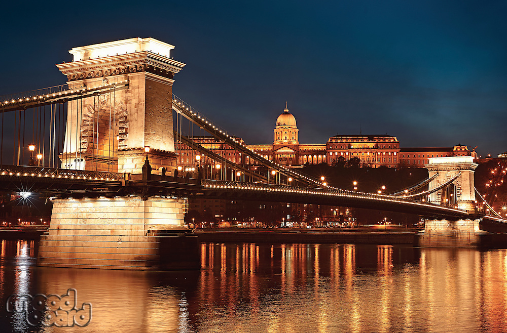 Dusk cityscape of the Chain bridge across the river Danube with the Buda castle in the background in the Hungarian capital  Budapest