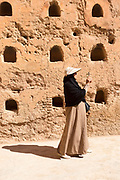 Visitors admire architecture at the El Badi Palace, Marrakesh, Morocco, 2016–04-22.<br /><br />The El Badi Palace and sunken gardens are a short walk from Bahia, within the old, towering Medina walls of the Mellah. <br /><br />Commissioned by the Arab Saadian sultan Ahmad-al-Mansur and completed in 1593, the complex took 25 years to build and is considered to be some of the finest examples of Saadian architecture in Moroco. <br />A ruined palace, the site is often being renovated and restored, but remains to be many peoples favourite Marrakesh palace experience.