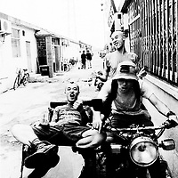 "BEIJING, HAIDIAN DISTRICT, CHINA - AUGUST 15: a group of punks hang out together in the alley outside the Scream Bar before a punk show August 15, 1999 in the Haidan district of Beijing, China. In the spring of 1998, a handful of youngsters teamed up to unofficially rebel against conformist Chinese life. They shaved their heads, and founded bands with names like ""Brain Failure"" and ""Anarchy Boys."" Although the majority of the punks came from well-off families, they preferred to live in self-imposed poverty. The Scream Bar and its surrounding dusty alleyways in the student district became the center of youthful rebellion until it was finally closed in 2000. The punks bands have moved on to other bars in Beijing, some received contracts with foreign record companies and even toured in Europe, Japan and the U.S."