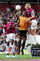 Fotball<br /> 2004/2005<br /> Foto: SBI/Digitalsport<br /> NORWAY ONLY<br /> <br /> West Ham v Wolverhampton Wanderers<br /> Coca-Cola Championship.  Upton Park.<br /> 02/10/2004<br /> <br /> West Ham's Calum Davenport and Chris Powell head the ball against Wolves' Carl Cort
