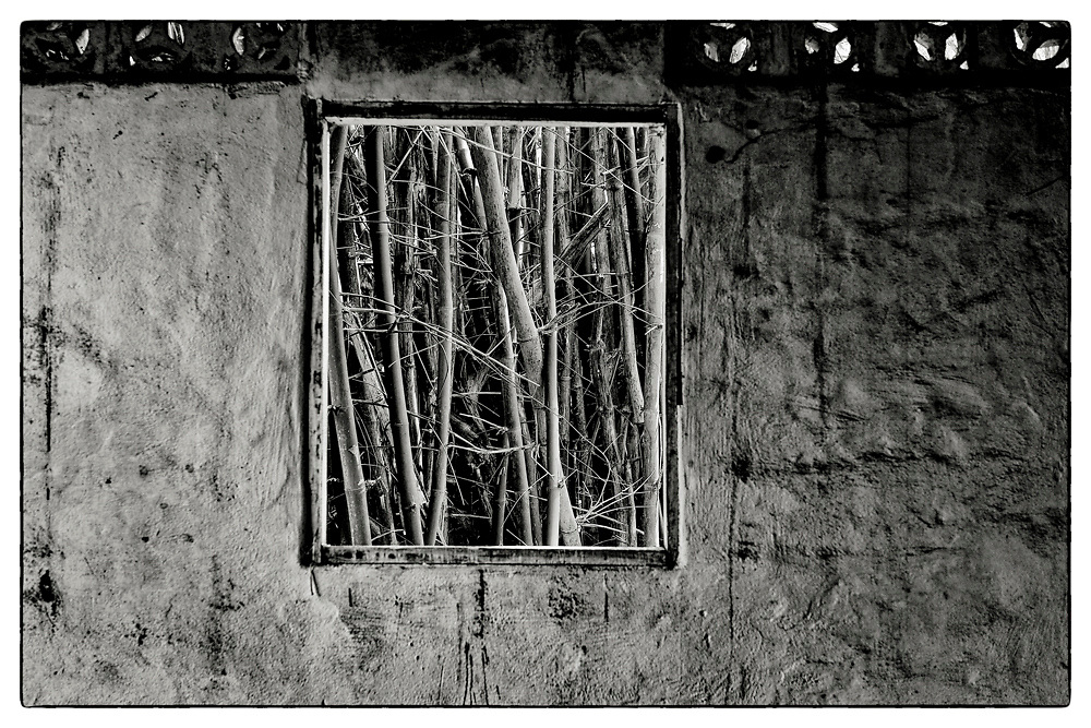 "An interior view from within an abandoned Monk's meditation hut set within a dense bamboo forest, in the grounds of the Pha Koeng Buddhist temple, Chaiyaphum Province, Northeast Thailand, 2014. From the series: ""Pha Koeng"" (2011-2017)."