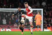 Arsenal Defender Shkodran Mustafi (20) pushes past CSKA Moscow Forward Vitinho (11) during the Europa League match between Arsenal and CSKA Moscow at the Emirates Stadium, London, England on 5 April 2018. Picture by Stephen Wright.