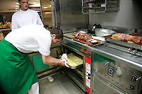 Restaurant Bras, Laguiole, in the Aubrac region, France..Preparation and eating of the staff meal -  the roast pork and potatoes