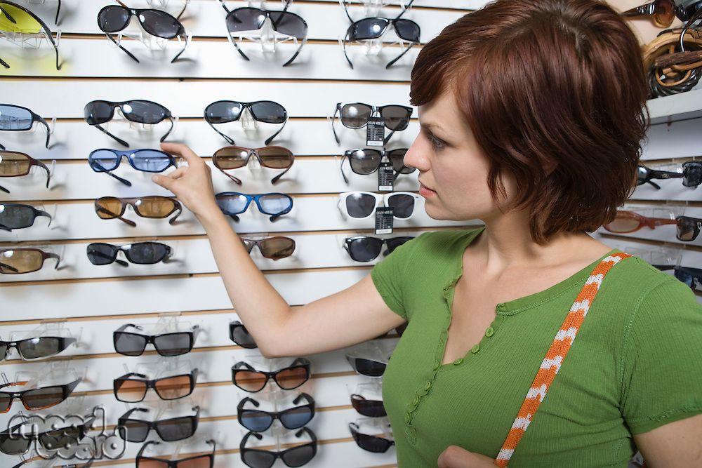 Young woman shopping for glasses