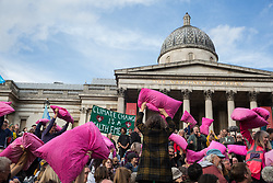 London, UK. 16 October, 2019. Climate activists from Extinction Rebellion hold up pink pillows as they defy the Metropolitan Police prohibition on Extinction Rebellion Autumn Uprising protests throughout London under Section 14 of the Public Order Act 1986 by attending a Right to Protest assembly in Trafalgar Square. Pink pillows were confiscated by police officers towards the beginning of the Autumn Uprising.