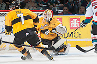 KELOWNA, CANADA - MAY 13: Jordan Papirny #33 of Brandon Wheat Kings defends the net against the Kelowna Rockets on May 13, 2015 during game 4 of the WHL final series at Prospera Place in Kelowna, British Columbia, Canada.  (Photo by Marissa Baecker/Shoot the Breeze)  *** Local Caption *** Jordan Papirny;