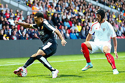 Ikechi Anya of Watford under pressure from Luismi of Sevilla - Mandatory by-line: Jason Brown/JMP - Mobile 07966 386802 31/07/2015 - SPORT - FOOTBALL - Watford, Vicarage Road - Watford v Sevilla - Pre-Season Friendly
