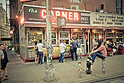 People dining and ordering takeouts at the Corner Deli in SoHo, Manhattan, New york, 2010.