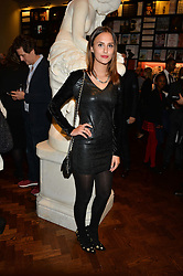LUCY WATSON at a party to celebrate the launch of the Maison Assouline Flagship Store at 196a Piccadilly, London on 28th October 2014.  During the evening Valentino signed copies of his new book - At The Emperor's Table.