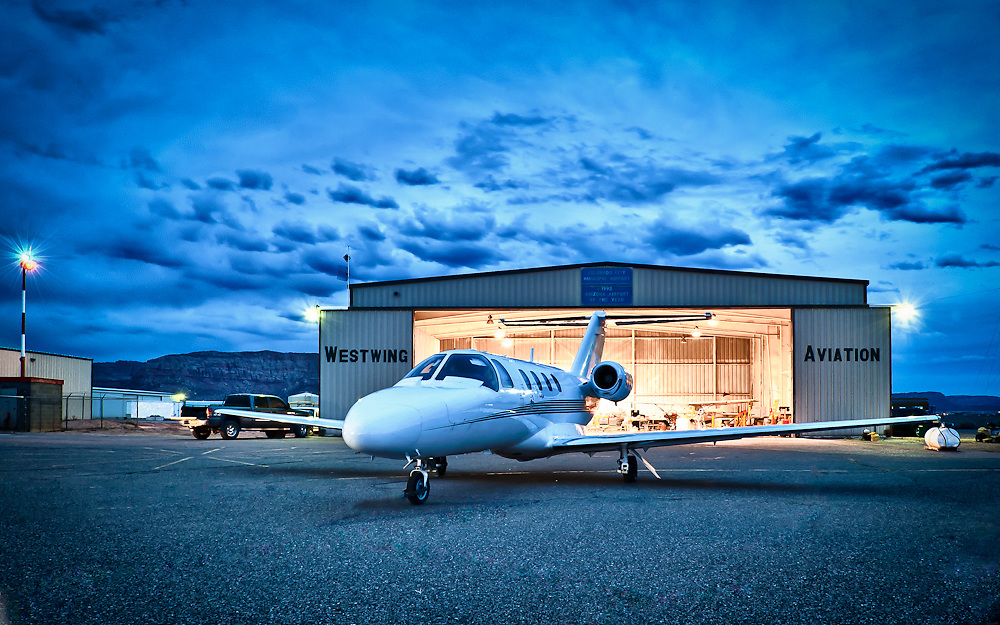 Image of citation jet in front of hanger at Colorado City Municipal Airport at dusk.