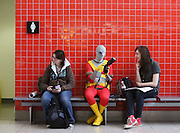 UNITED KINGDOM, London: 24 February 2013. <br /> Comic Con Feature.<br /> Cosplay fans take a rest next to the public toilets on the outside of the exhibition.<br /> Photo: Rick Findler / Story Picture Agency
