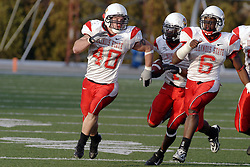 25 November 2006: Jesse Caesar gets protection from Kye Stewart and Cameron Siskowic after intercepting a Panther pass late in the 4th quarter.&#xD;The Redbirds romped the Panthers by a score of 24-13.&#xD;This game was a 1st round NCAA Division 1 Playoff held at O'Brien Stadium on the campus of Eastern Illinois University in Charleston Illinois.<br />