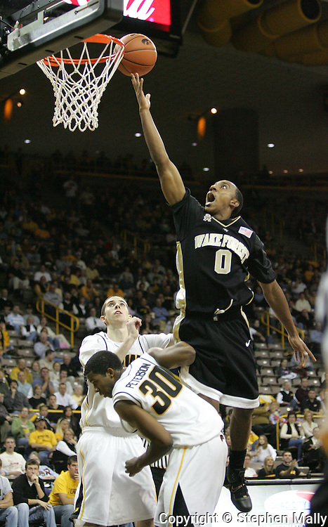 26 NOVEMBER 2007: Wake Forest guard Jeff Teague (0) drives to the basket over Iowa guard Jeff Peterson (30) in Wake Forest's 56-47 win over Iowa at Carver-Hawkeye Arena in Iowa City, Iowa on November 26, 2007.