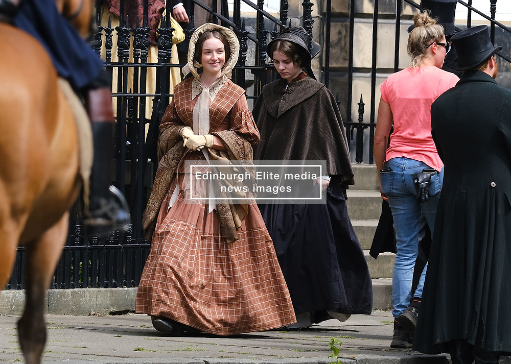 "Moray Place in Edinburgh's Georgian old town was turned into 19th century London for Julian Fellowes' new ITV show ""Belgravia"".<br /> <br /> Pictured: Extras dressed in 19th century garb walk around during takes<br /> <br /> Alex Todd 