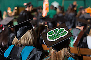 A bobcat paw print decorates the hat of a graduate at Friday May 2, 2014 commencement ceremony at Ohio University.  Photo by Ohio University / Jonathan Adams