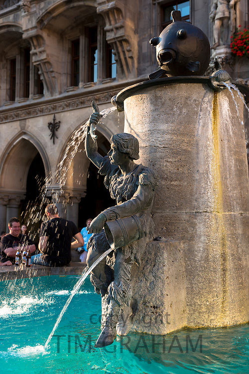 Young people gather by the fountain in Marienplatz in Munich, Bavaria, Germany