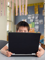 School Boy Using a Laptop