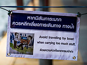 15 SEPTEMBER 2017 - BANGKOK, THAILAND: A sign warns people who have a lot of stuff not to use Khlong Saen Saeb passenger boats at the Asok Pier, on Sukhumvit Soi 21. Tens of thousands of passengers ride the boat every day, commuting into Bangkok from the eastern suburbs.      PHOTO BY JACK KURTZ