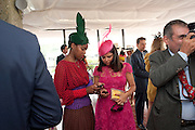 SUSAN BENDER; Daniella Issa Helayel;  , Glorious Goodwood. Ladies Day. 28 July 2011. <br /> <br />  , -DO NOT ARCHIVE-© Copyright Photograph by Dafydd Jones. 248 Clapham Rd. London SW9 0PZ. Tel 0207 820 0771. www.dafjones.com.