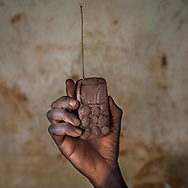 A phone made out of clay by Julius Caesar, 8, on August 17, 2017. He's one of the many children who had to leave the war in South Sudan and come to the Bidibidi Refugee Settlement in northwestern Uganda. (photo by Nora Lorek)