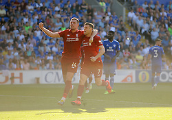 James Milner of Liverpool scores from the spot making it 0-2- Mandatory by-line: Nizaam Jones/JMP - 21/04/2019 -  FOOTBALL - Cardiff City Stadium - Cardiff, Wales -  Cardiff City v Liverpool - Premier League