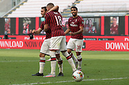 AC Milan's Croatian striker Ante Rebic celebrates with Turkish midfielder Hakan Calhanoglu and Brazilian midfielder Lucas Paqueta during the Serie A match at Giuseppe Meazza, Milan. Picture date: 28th June 2020. Picture credit should read: Jonathan Moscrop/Sportimage