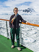 In sunny weather, Carol Dempsey views sea ice in the Southern Ocean offshore from Graham Land, the north part of the Antarctic Peninsula, in Antarctica. For licensing options, please inquire.