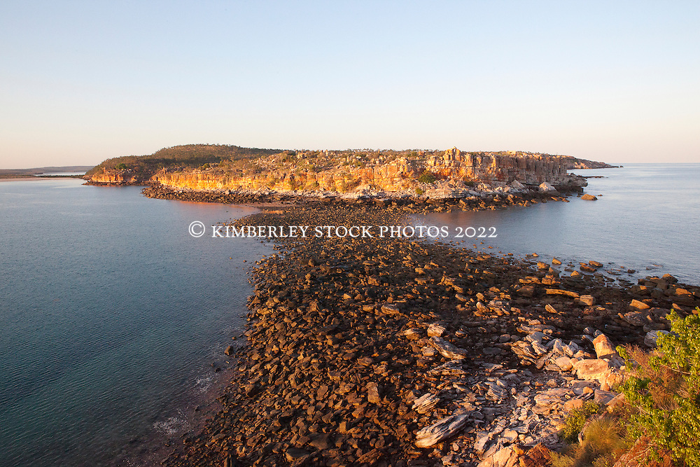 Early morning view from the cliffs at Hall Point in Camden Sound.  Low tide exposes a rock bar which is covered at high tide.