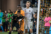 LAFC midfielder Mark-Anthony Kaye (14) waits for a corner kick with Houston Dynamo forward Alberth Ellis (17) and goalkeeper Joe Willis (23) on defense during a MLS soccer game, Saturday, Sept 25, 2019, in Los Angeles. LAFC wins 3-1. (Jon Endow/Image of Sport)
