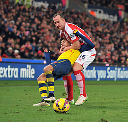 Stoke's Charlie Adam grabs hold of Arsenal's Alexis Sanchez - Photo mandatory by-line: Dougie Allward/JMP - Mobile: 07966 386802 - 06/12/2014 - SPORT - Football - Stoke - Britannia Stadium - Stoke City v Arsenal - Barclays Premie League