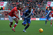 Birmingham City midfielder Jacques Maghoma and Bristol City defender Mark Little chase the ball during the Sky Bet Championship match between Bristol City and Birmingham City at Ashton Gate, Bristol, England on 30 January 2016. Photo by Alan Franklin.