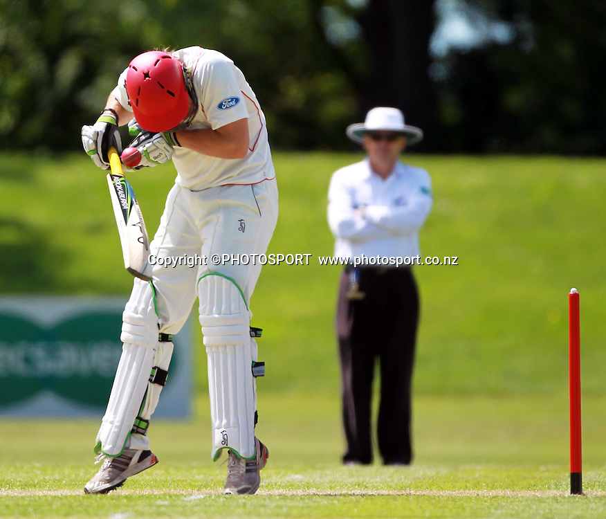Canterbury batsmen George Worker is hit in the helmet during play on the first day of the first game of the season. Canterbury Wizards v Otago Volts, Plunket Shield Game held at Mainpower Oval, Rangiora, Monday 07 November 2011. Photo : Joseph Johnson / photosport.co.nz