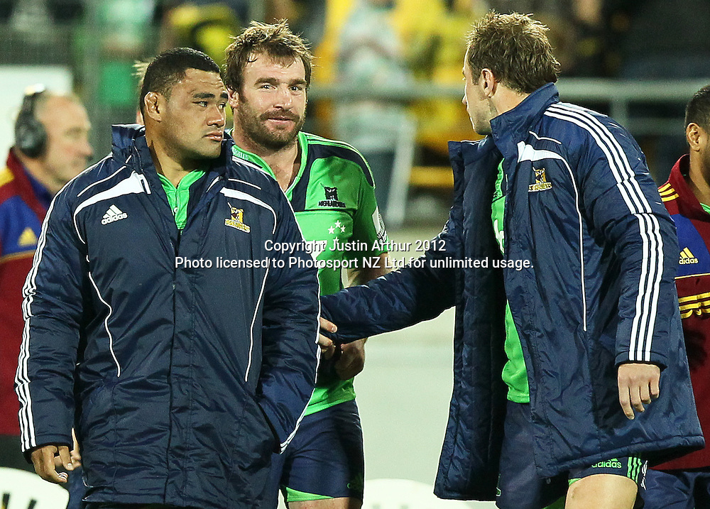 Highlanders' Andrew Hore (center) shakes hands with team mate Jimmy Cowan after the 2012 Super Rugby season, Hurricanes v Highlanders at Westpac Stadium, Wellington, New Zealand on Saturday 17 March 2012. Photo: Justin Arthur / Photosport.co.nz