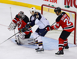 Nov 1, 2008; Newark, NJ, USA; New Jersey Devils goalie Kevin Weekes (1) makes a save while Atlanta Thrashers right wing Colby Armstrong (20) and New Jersey Devils defenseman Bryce Salvador (24) battle for the rebound during the third period at the Prudential Center. The Devils defeated the Thrashers 6-1.