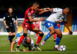 Tom Ince of Huddersfield Town challenges Chris Humphrey of Bury - Mandatory by-line: Matt McNulty/JMP - 16/07/2017 - FOOTBALL - Gigg Lane - Bury, England - Bury v Huddersfield Town - Pre-season friendly