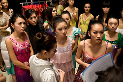 """Young women, including Pen Wei Fei, 16, center, participate in """"Miss. International"""" beauty contest in Beijing, China, Nov. 7, 2009."""