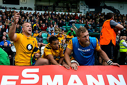 Tom Cruse, Marcus Watson and Brad Shields of Wasps look on nervously as their teammates on the field hold on to victory over Northampton Saints - Mandatory by-line: Robbie Stephenson/JMP - 28/09/2019 - RUGBY - Franklin's Gardens - Northampton, England - Northampton Saints v Wasps - Premiership Rugby Cup