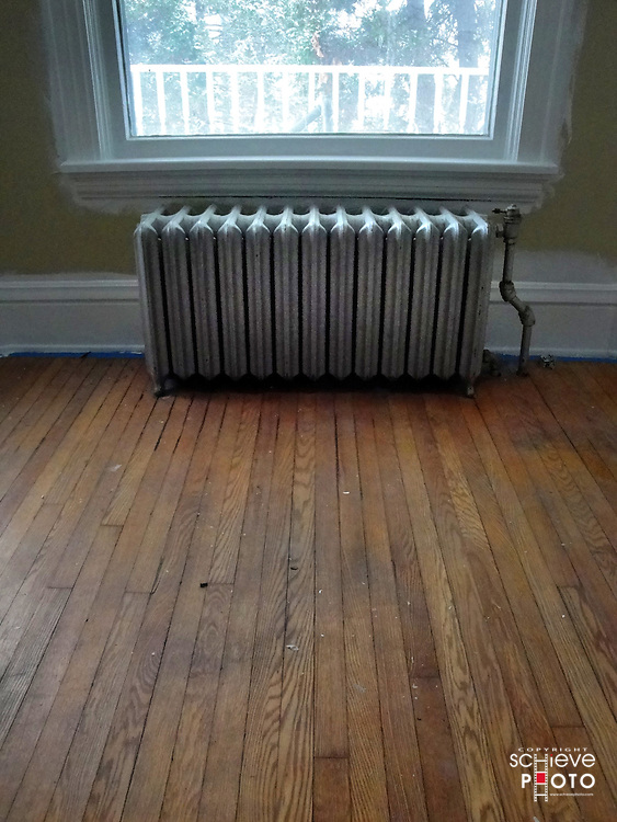 Radiator in an empty bedroom.