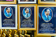 09 OCTOBER 2014 - BANGKOK, THAILAND: Portraits of Bhumibol Adulyadej, the King of Thailand for sale near Siriraj Hospital. The King has been hospitalized at Siriraj Hospital since Oct. 4 and underwent emergency gall bladder removal surgery Oct. 5. The King is also known as Rama IX, because he is the ninth monarch of the Chakri Dynasty. He has reigned since June 9, 1946 and is the world's longest-serving current head of state and the longest-reigning monarch in Thai history, serving for more than 68 years. He is revered by the Thai people and anytime he goes into the hospital thousands of people come to the hospital to sign get well cards.   PHOTO BY JACK KURTZ