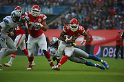 Kansas City Chiefs Charcandrick West getting tackled during the Kansas City Chiefs v Detroit Lions  NFL International Series match at Wembley Stadium, London, England on 1 November 2015. Photo by Matthew Redman.