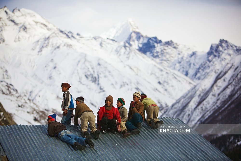 Kids playing on top of a roof at Chitkul, also known as the last village of India. <br />